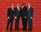 Lovie Smith poses with members of the Glazer family after he is introduced as the new coach of Tampa Bay Buccaneers at a press conference January 6...