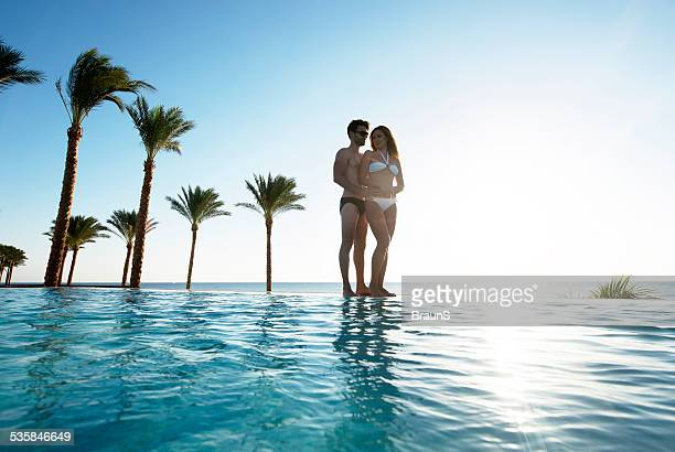 Loving couple at infinity pool.