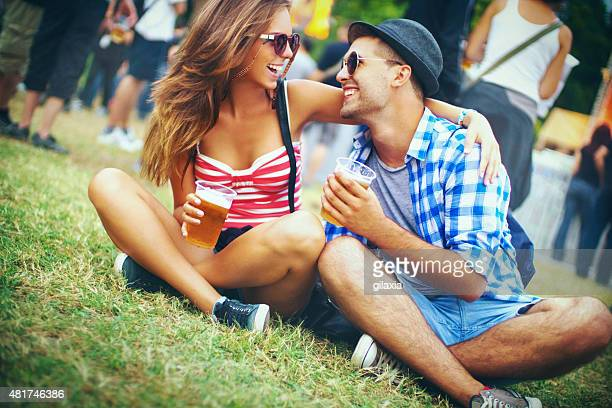 Loving couple at music festival.