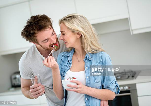 Loving couple eating a healthy snack at home