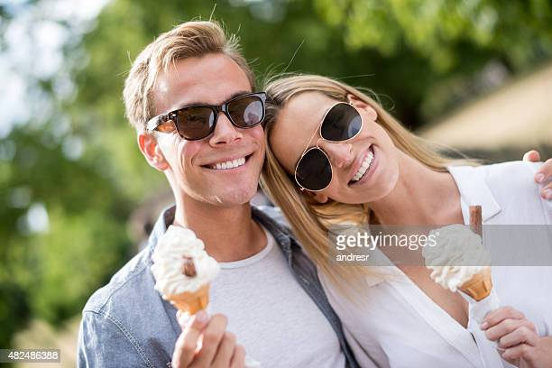 Loving couple eating ice cream at the park