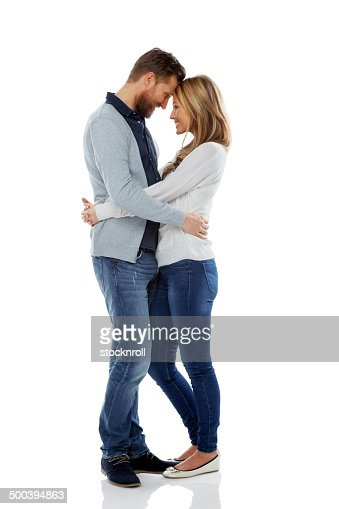 Loving couple embracing over white