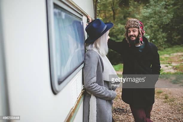 Loving couple enjoying cold autumn days in nature