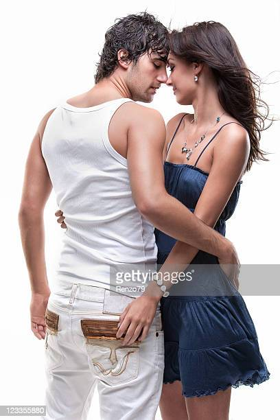 Loving couple holding each other posing in front of camera