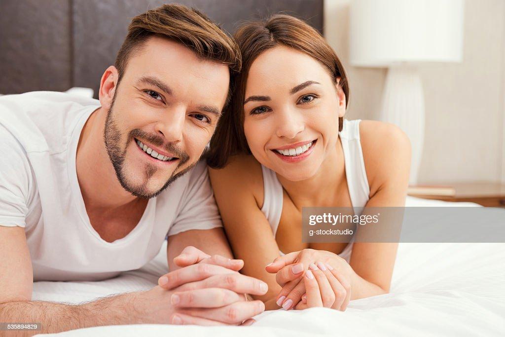 Loving couple in bed. : Stockfoto