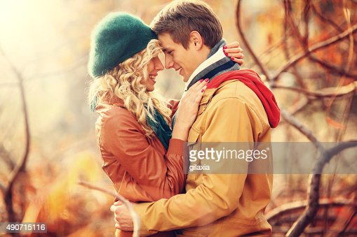 Loving couple in park.