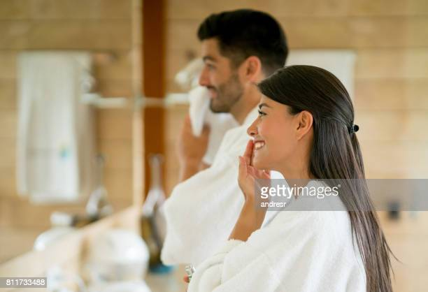 Loving couple in the bathroom following their morning routine