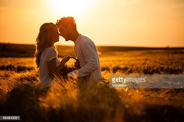 Loving couple in wheat field
