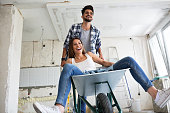Loving couple is having fun while they are renovating home