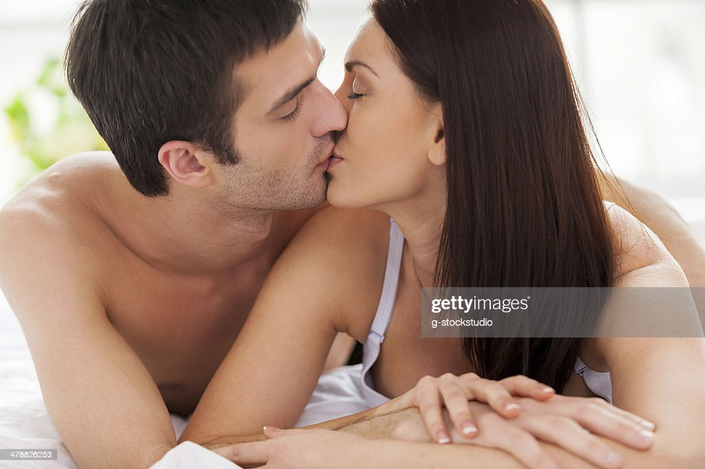Loving Couple Kissing In Bed. : Stock Photo