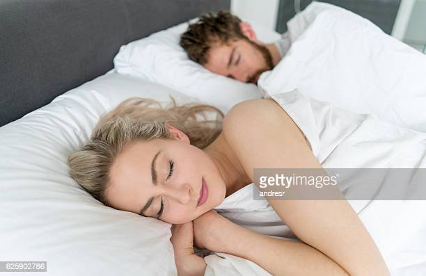 Loving couple sleeping in bed