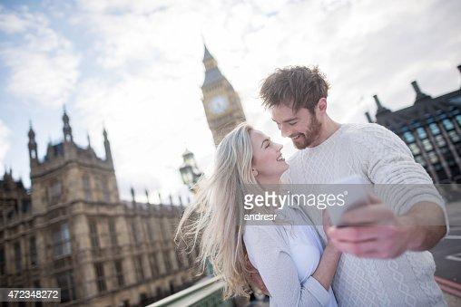 Loving couple taking a selfie in London