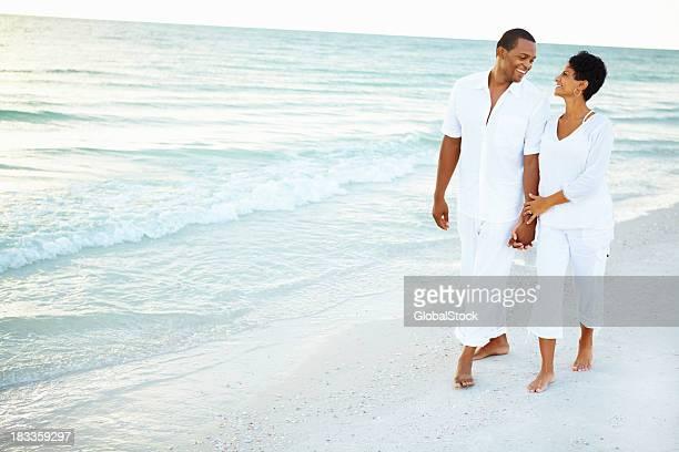 Loving couple walking along the beach