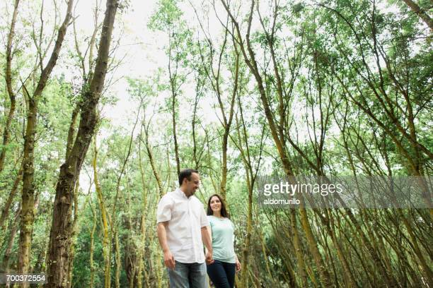 Loving couple walking hand by hand outdoors
