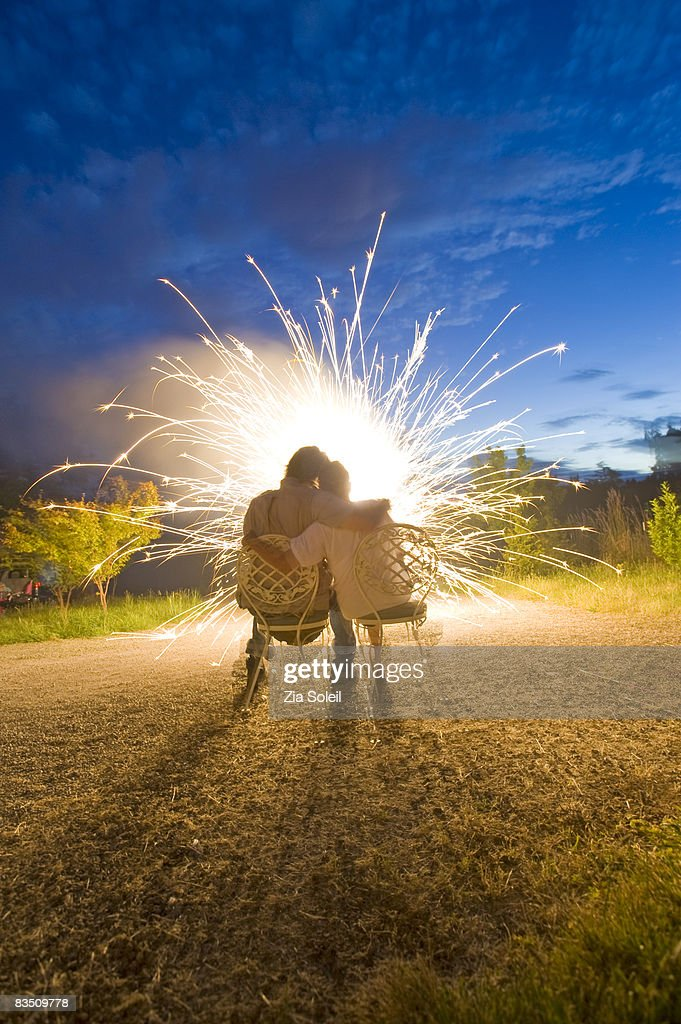 loving couple watching fireworks : Stock Photo