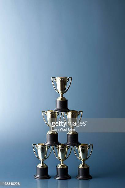 Loving cup trophies stacked in a pyramid
