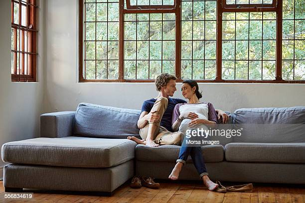 couples on couch stock photos and pictures getty images. Black Bedroom Furniture Sets. Home Design Ideas