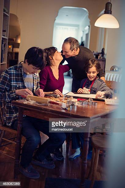 Loving family making gingerbread cookie at home.
