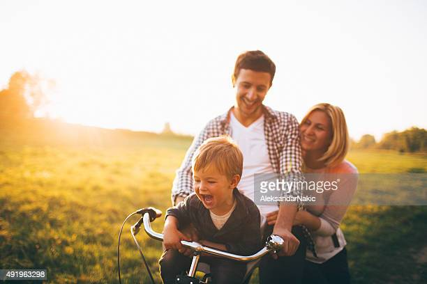 Loving family on a bicycle
