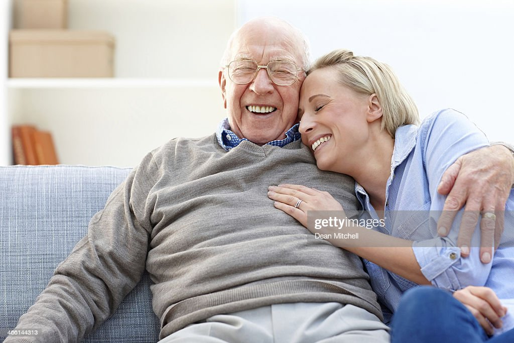 Loving father and daughter together on sofa : Stock Photo