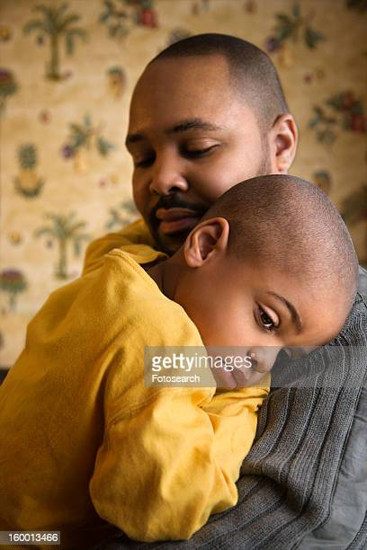 Loving Father Holding Young Son