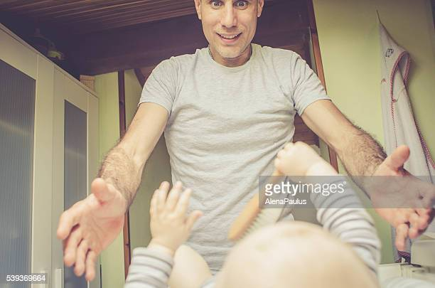 Loving Happy Father Changing Baby's Diaper