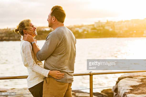 Loving Happy Middle Aged Fit Healthy Beach Couple at Sunset