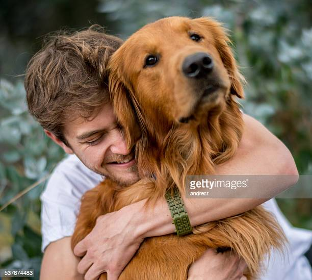 Loving man hugging his dog