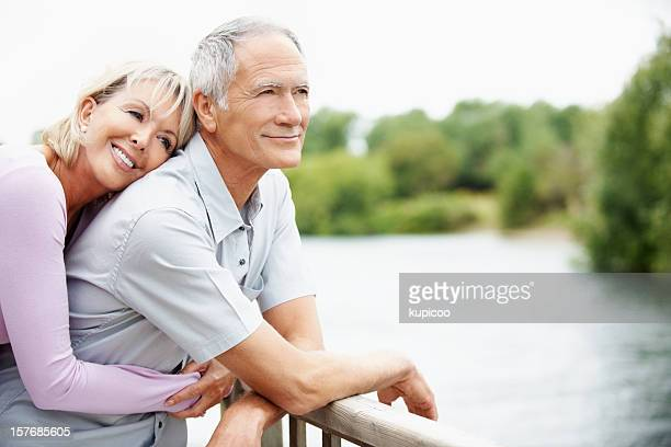 Loving mature woman embracing a man from back