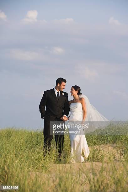 Loving newlyweds on hilltop