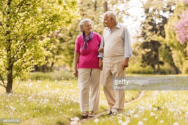 Loving old couple communicating during a spring walk outdoors.