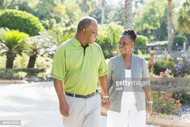 Loving senior African-American couple taking a walk