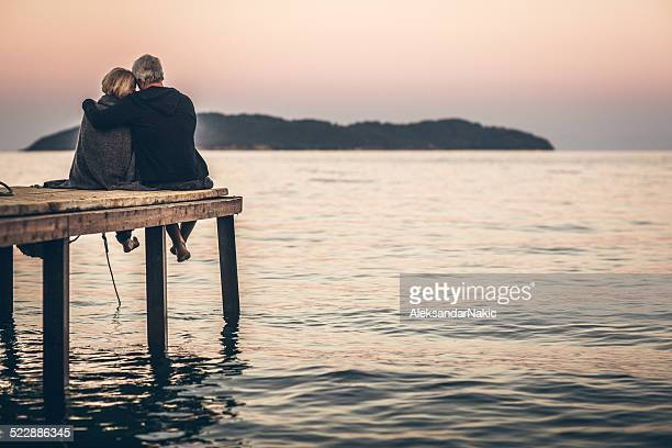 Loving senior couple enjoying the sunset
