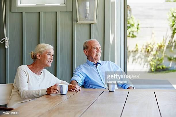 Loving senior couple having coffee