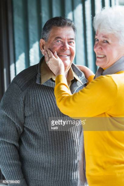 Loving senior couple, smiling looking at camera