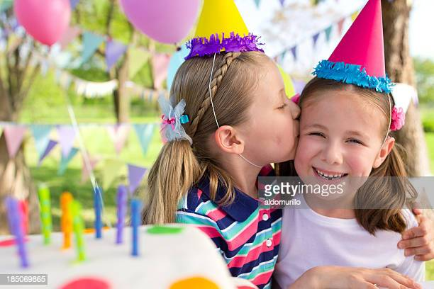 Loving sisters at a birthday party