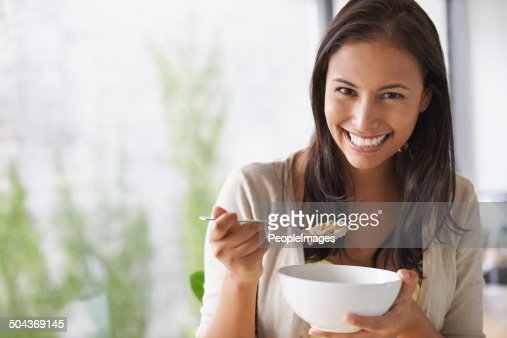 Loving the fresh taste of her morning cereal