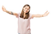 Portrait of loving young woman offering a hug over white background
