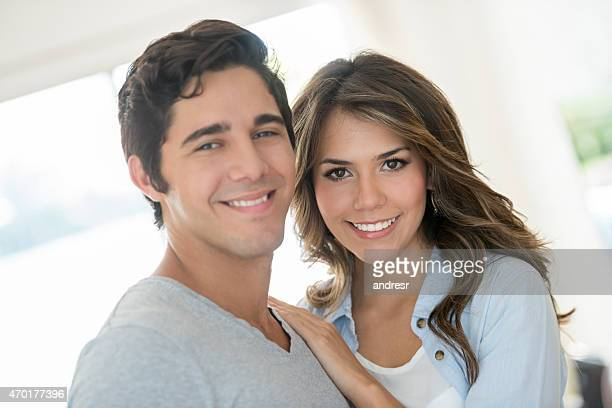 Loving young couple at home
