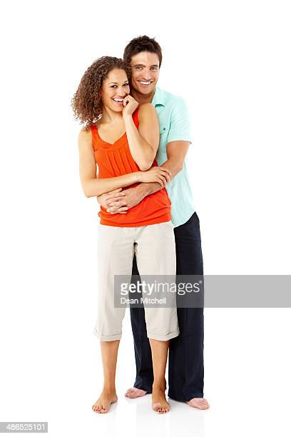 Loving young couple embracing on white