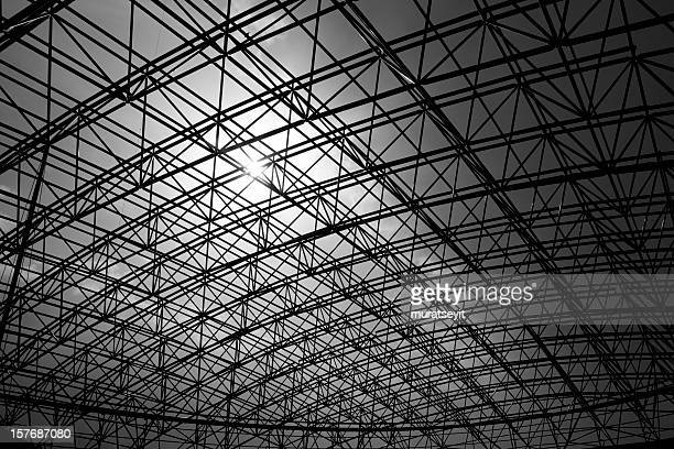 Low angle black and white photo of metal construction