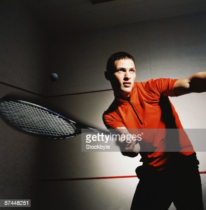 low angle close-up of a man hitting a shot in a game of tennis