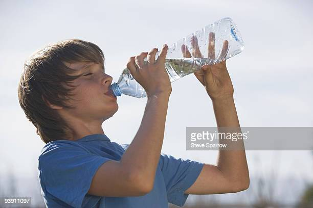 Low angle of boy drinking water