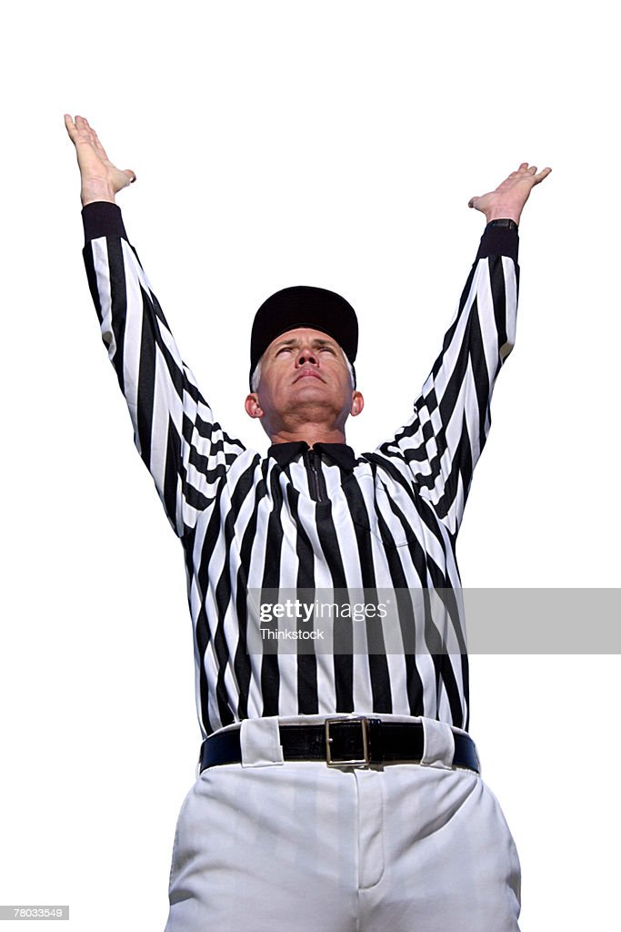 Low angle of referee signaling a touchdown.
