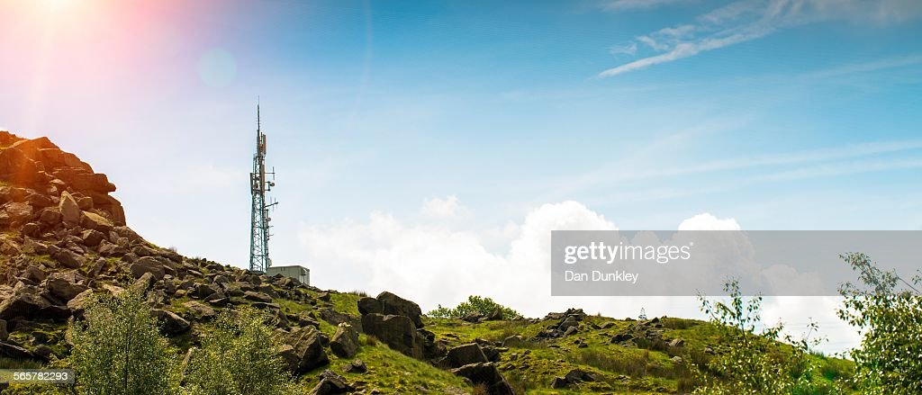 Low angle panoramic view of cell phone mast on hill, UK