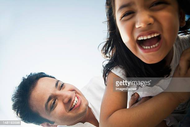 Low angle portrait of father with daughter (6-7)