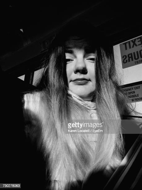 Low Angle Portrait Of Woman Traveling In Bus