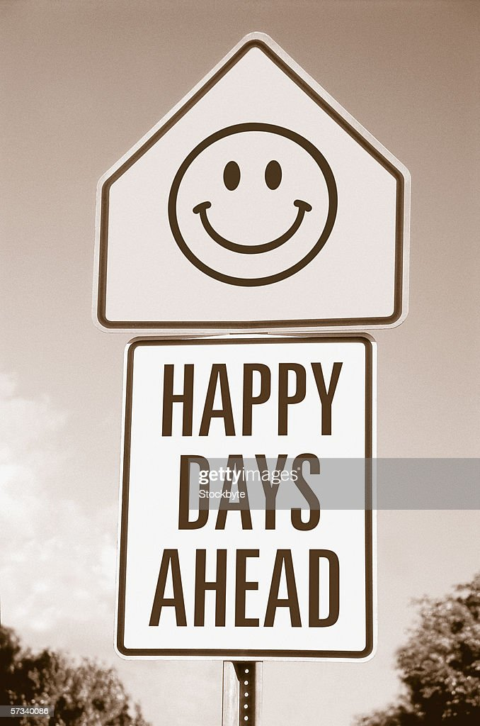 low angle sepia view of a road sign saying happy days ahead : Stock Photo