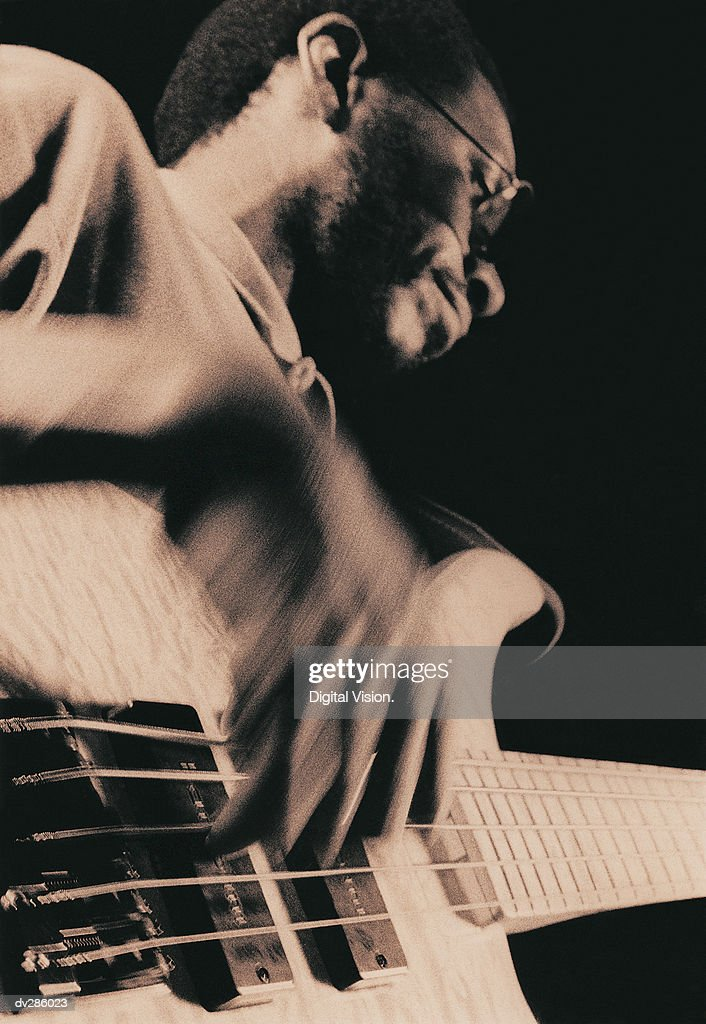 Low angle shot of guitarist : Stock Photo