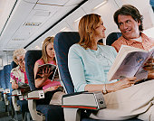 Low Angle Shot of Passengers Sitting on a Plane